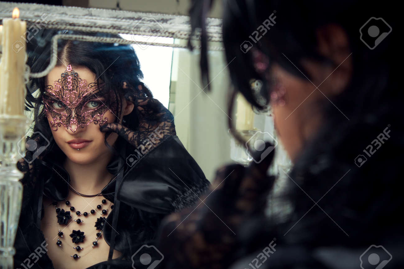 Pretty old-fashioned lady looking  in mirror Stock Photo - 20572051