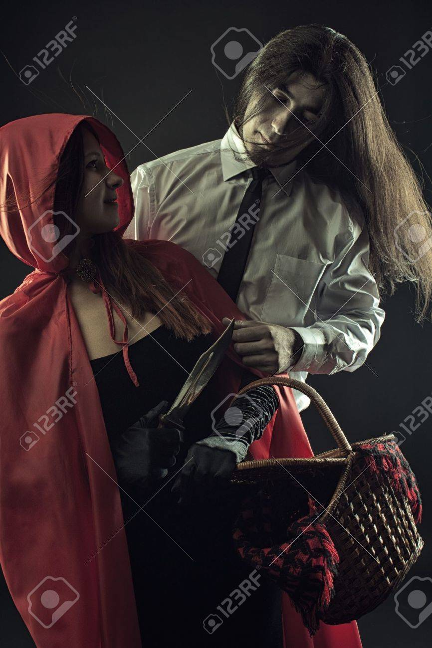 Red Riding Hood with basket and Bad Wolf over dark background Stock Photo - 20961718