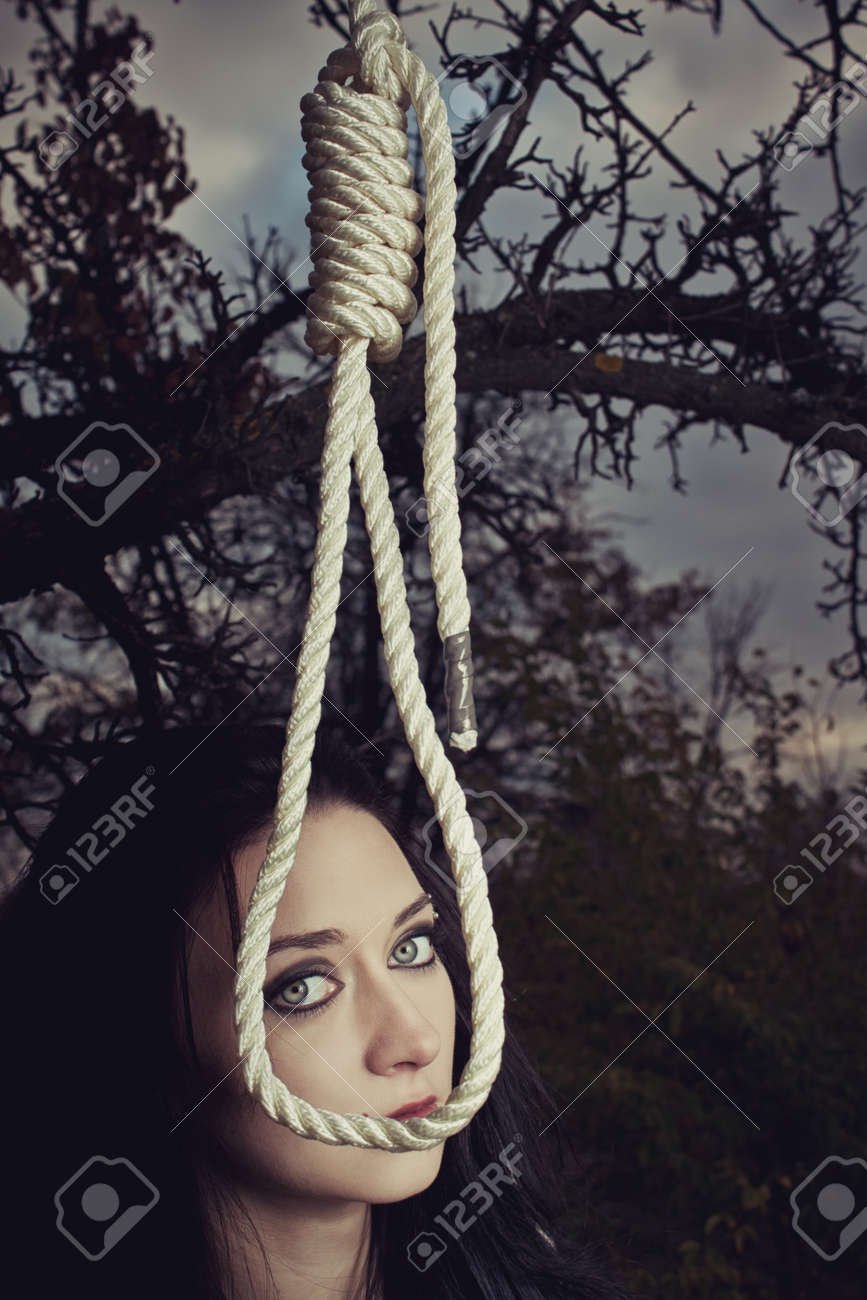 Pretty girl with gallows in the forest. Stock Photo - 21572351