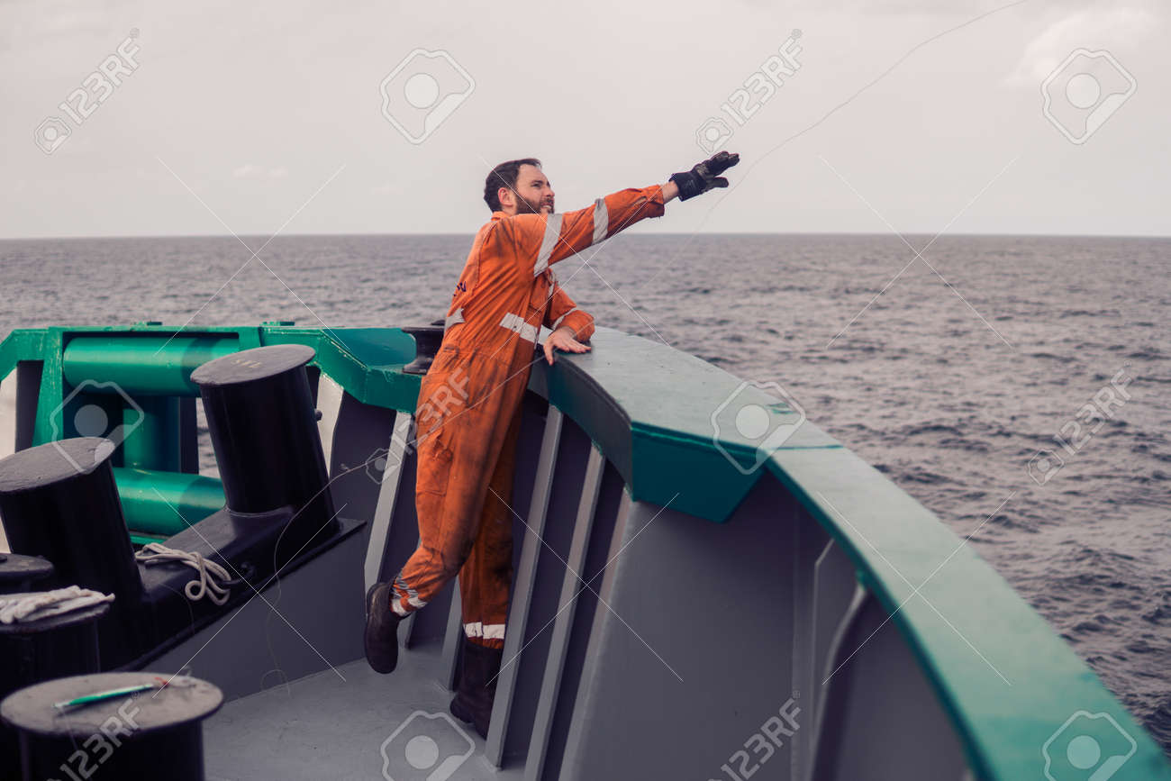 The fisherman throws a hook on a ship for catching tuna fish