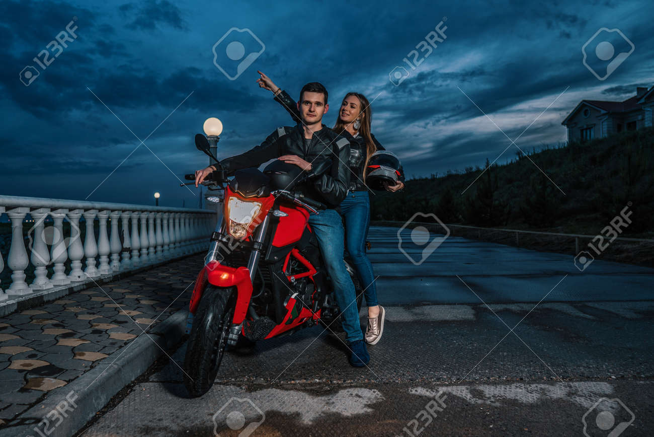 Biker Couple Man And Woman On A Black And Red Color Sport Motorcycle Stock Photo Picture And Royalty Free Image Image 102200559
