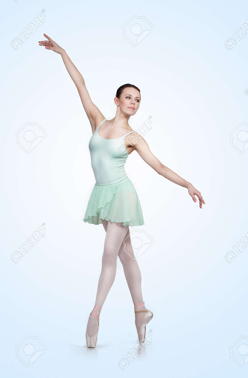 young beautiful ballerina on a gray background Stock Photo - 14195522