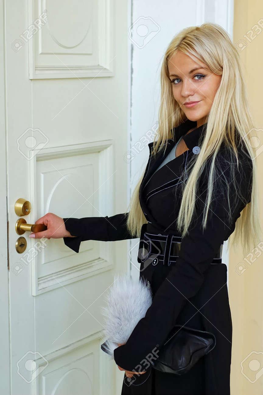 Stock Photo - Woman open door