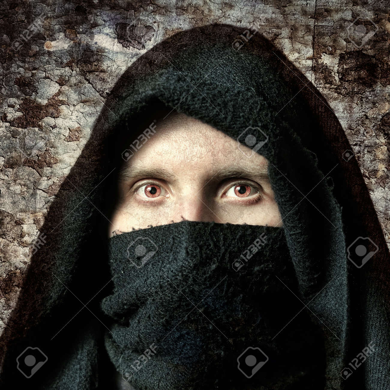 Spooky man in hood with terrible eyes Stock Photo - 7686961