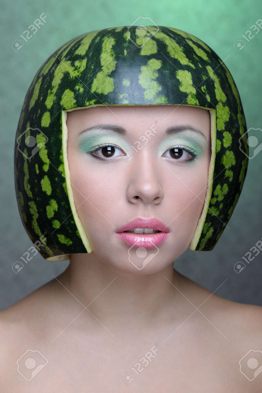 Face Of A Happy Young Woman Eating Yellow Melon Stock Photo ...