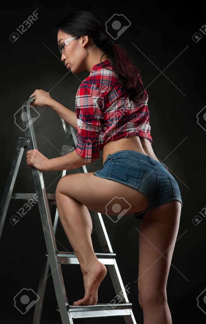 Sexy woman worker on ladder Stock Photo - 70185851