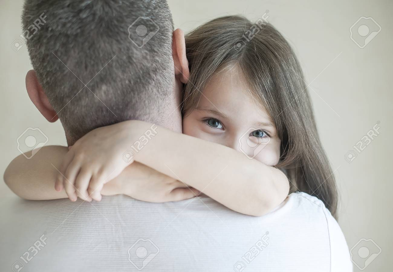Portrait Of Cute Little Girl Held In Fathers Arms Happy Loving