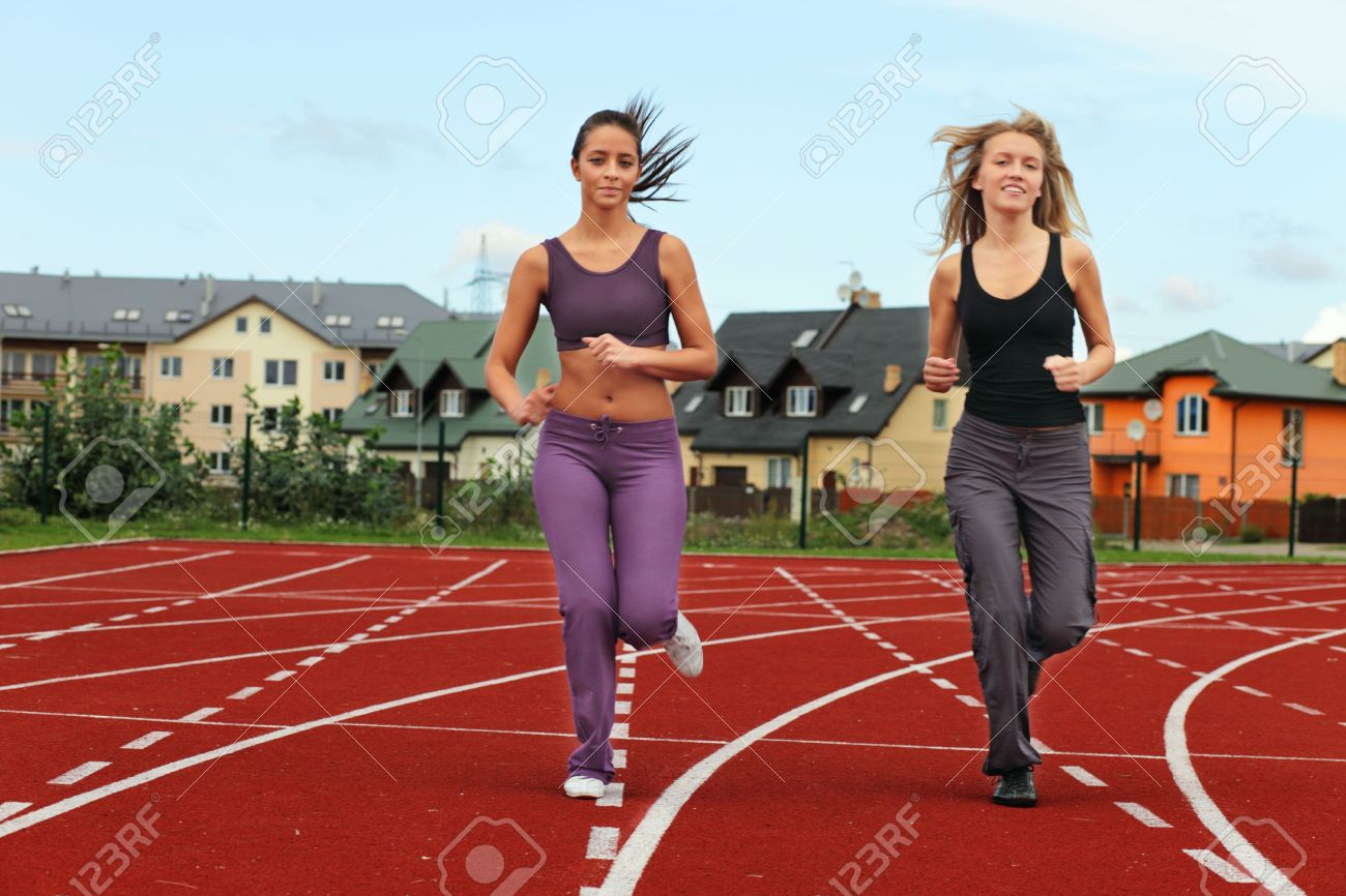 Two Girls Running In Stadium Stock Photo, Picture And Royalty Free Image.  Image 5522490.