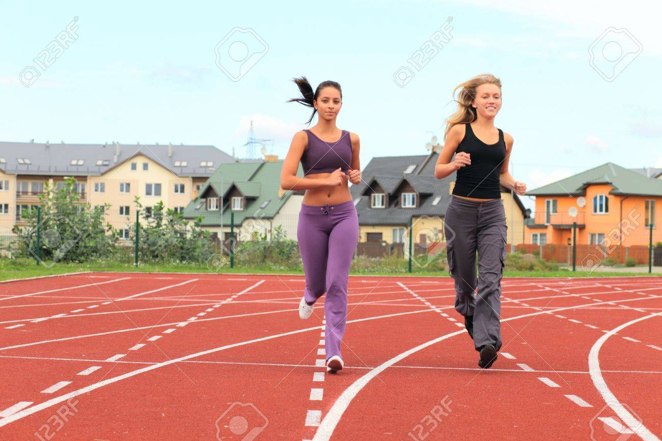 Two Girls Running In Stadium Stock Photo, Picture And Royalty Free Image.  Image 6358385.