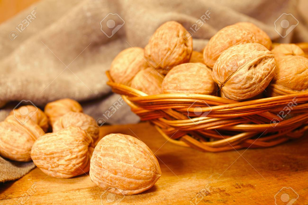 walnuts in basket,focus on a foreground Stock Photo - 6522635