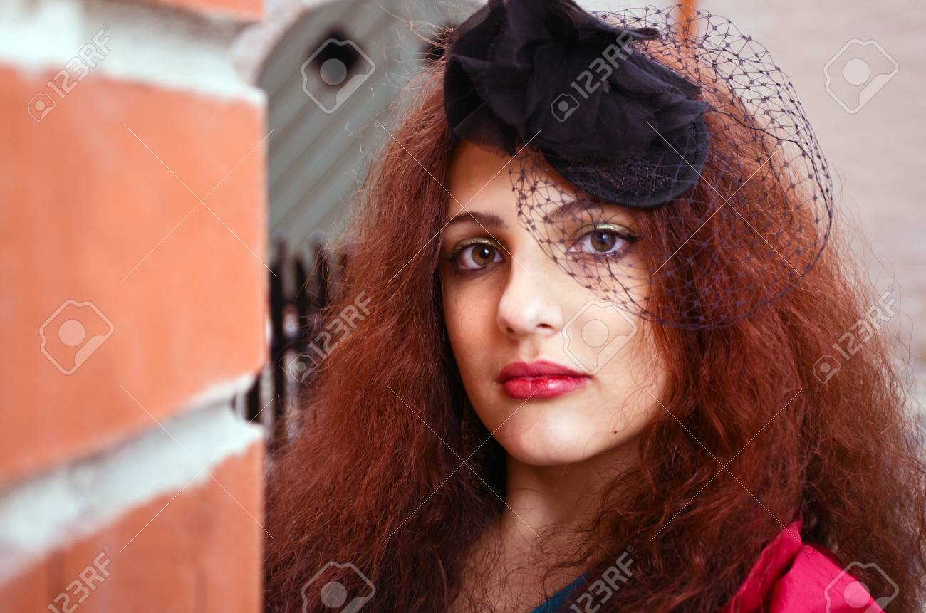 young beautiful woman in old city. Stock Photo - 10459900