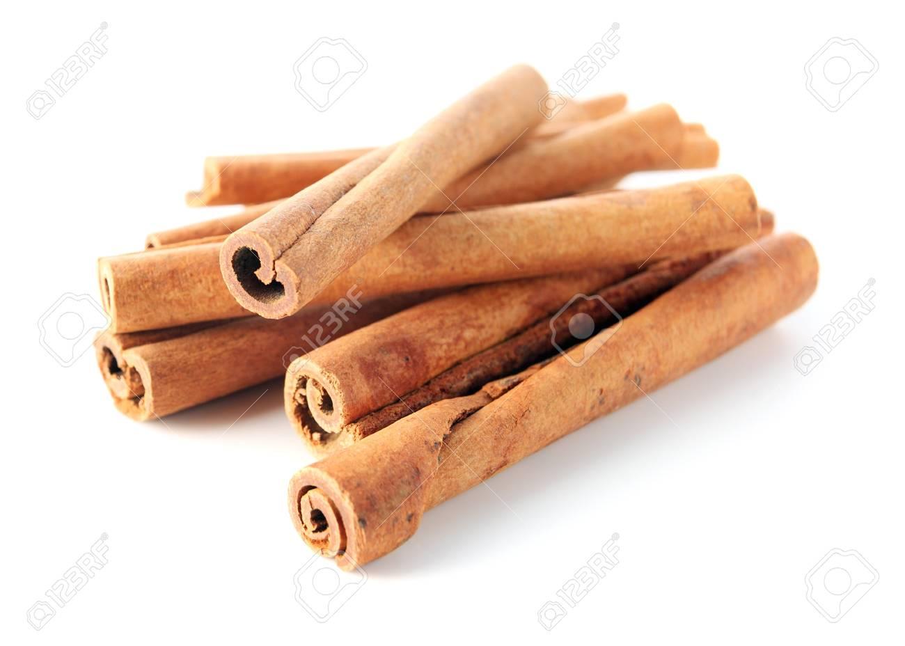 cinnamon sticks on a white background. Stock Photo - 13378346