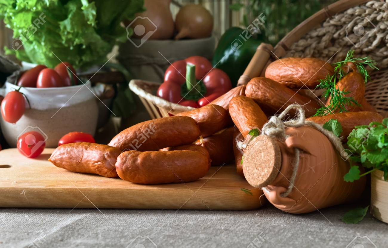 smoked sausage and greens on a linen cloth Stock Photo - 21963924