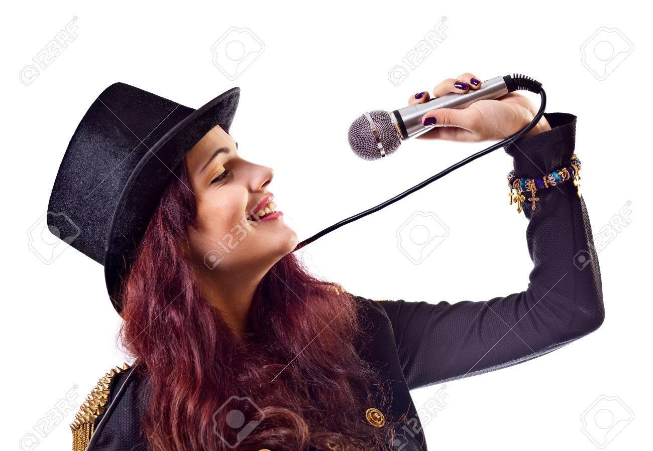 The actress in black suit with microphone, isolated on white Stock Photo - 25409422