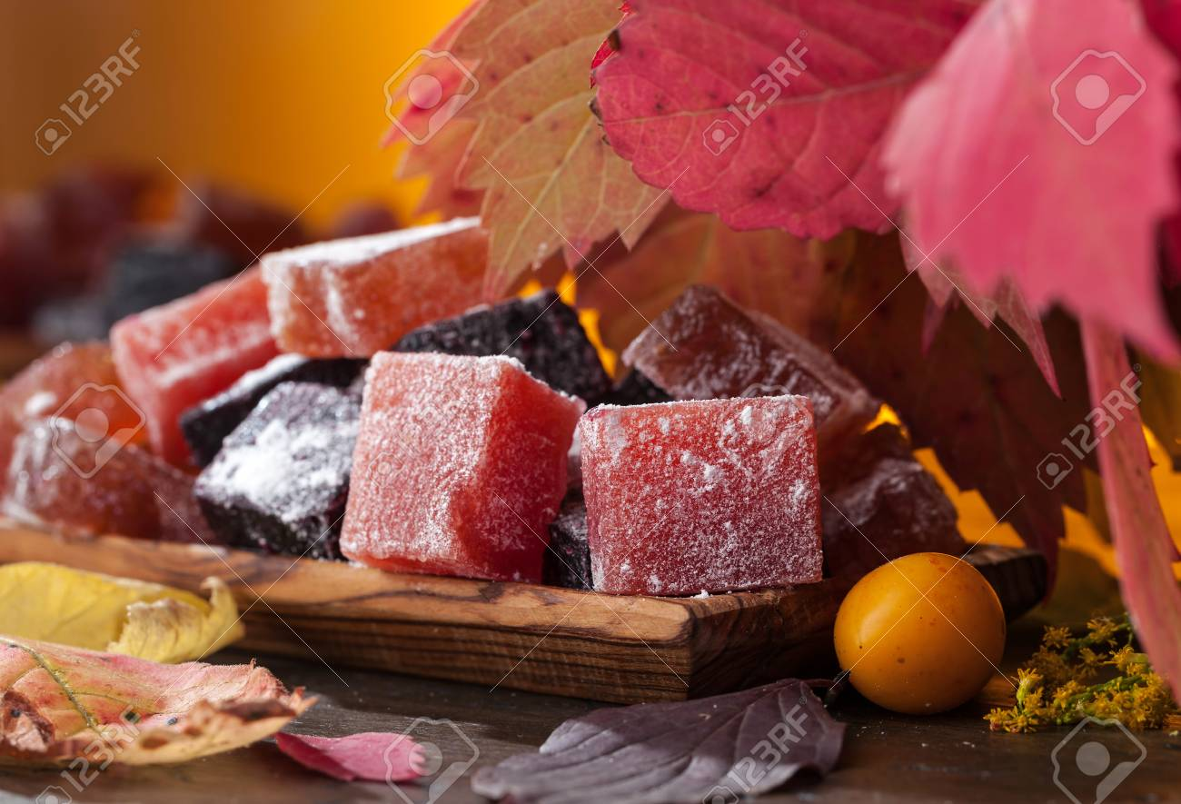 Homemade marmalade in wooden dish . Colorful autumn leaves. Stock Photo - 86582443