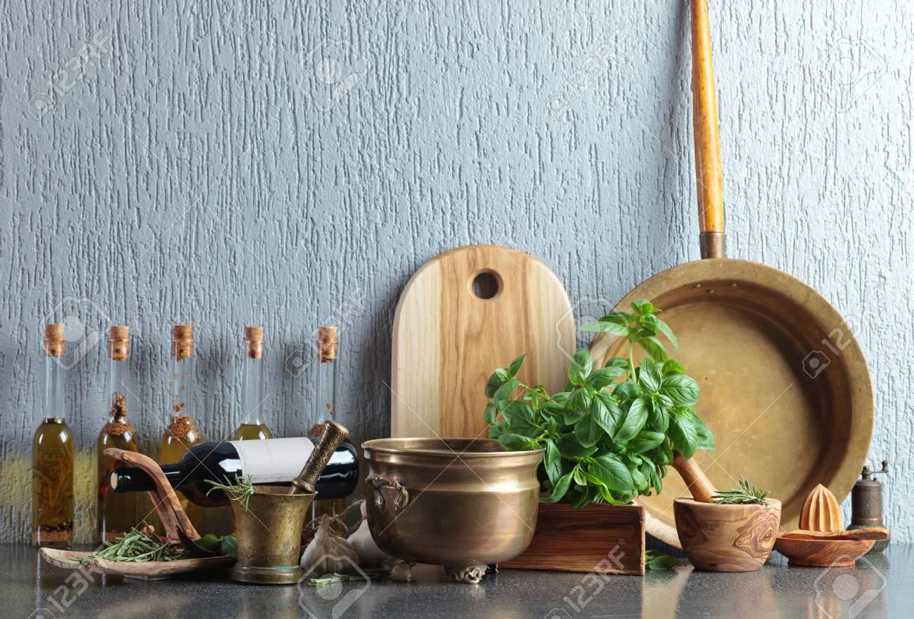 Vintage Kitchen Utensils With Basil And Bottles Of Olive Oil ...