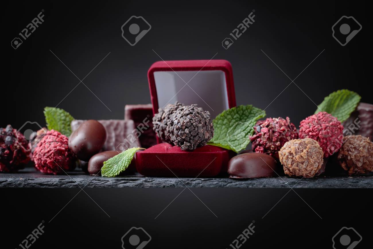 Various Chocolates With Mint Leaves And A Small Gift Box Copy