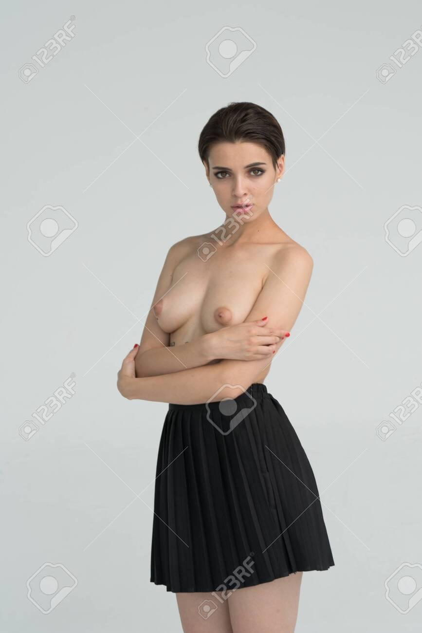 young beautiful girl posing in studio - 129295818