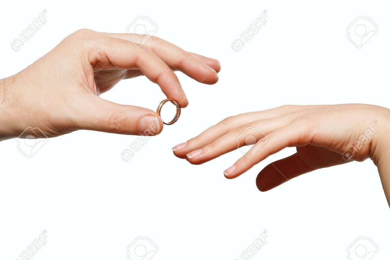 Male And Female Hand With A Wedding Ring Stock Photo Picture And