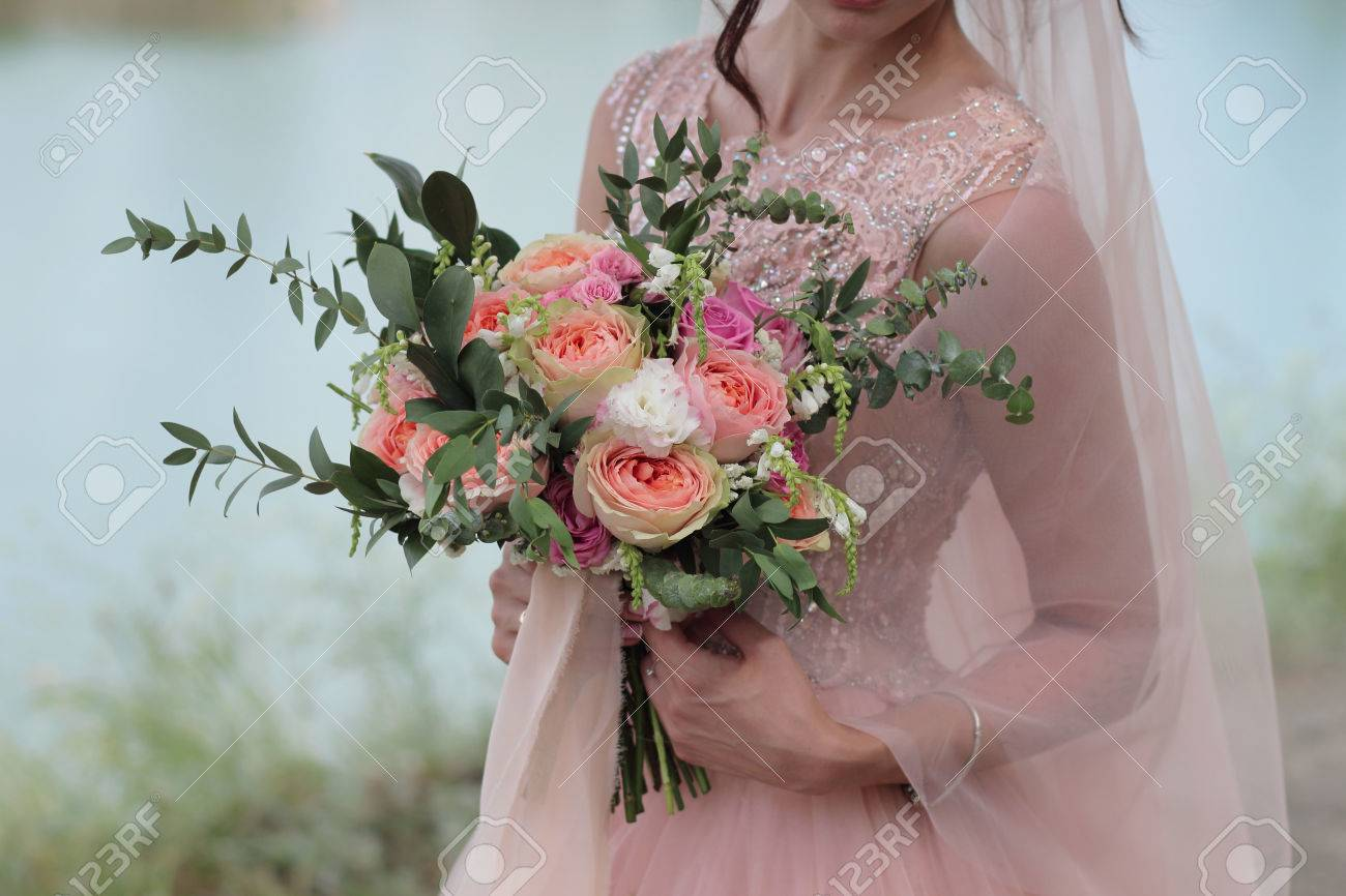 Bride Holding A Beautiful Bridal Bouquet. Wedding Bouquet Of.. Stock ...