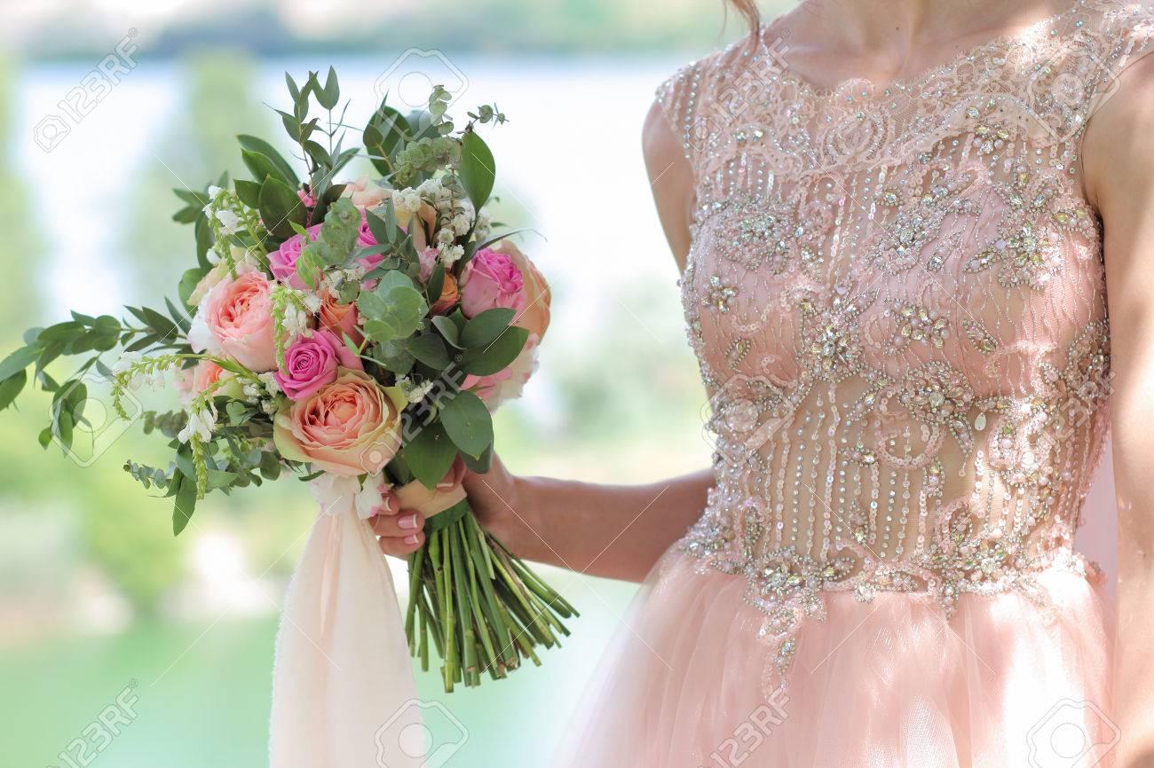 Beautiful bridal bouquet in hands of the bride wedding bouquet beautiful bridal bouquet in hands of the bride wedding bouquet of peach roses by david junglespirit Images