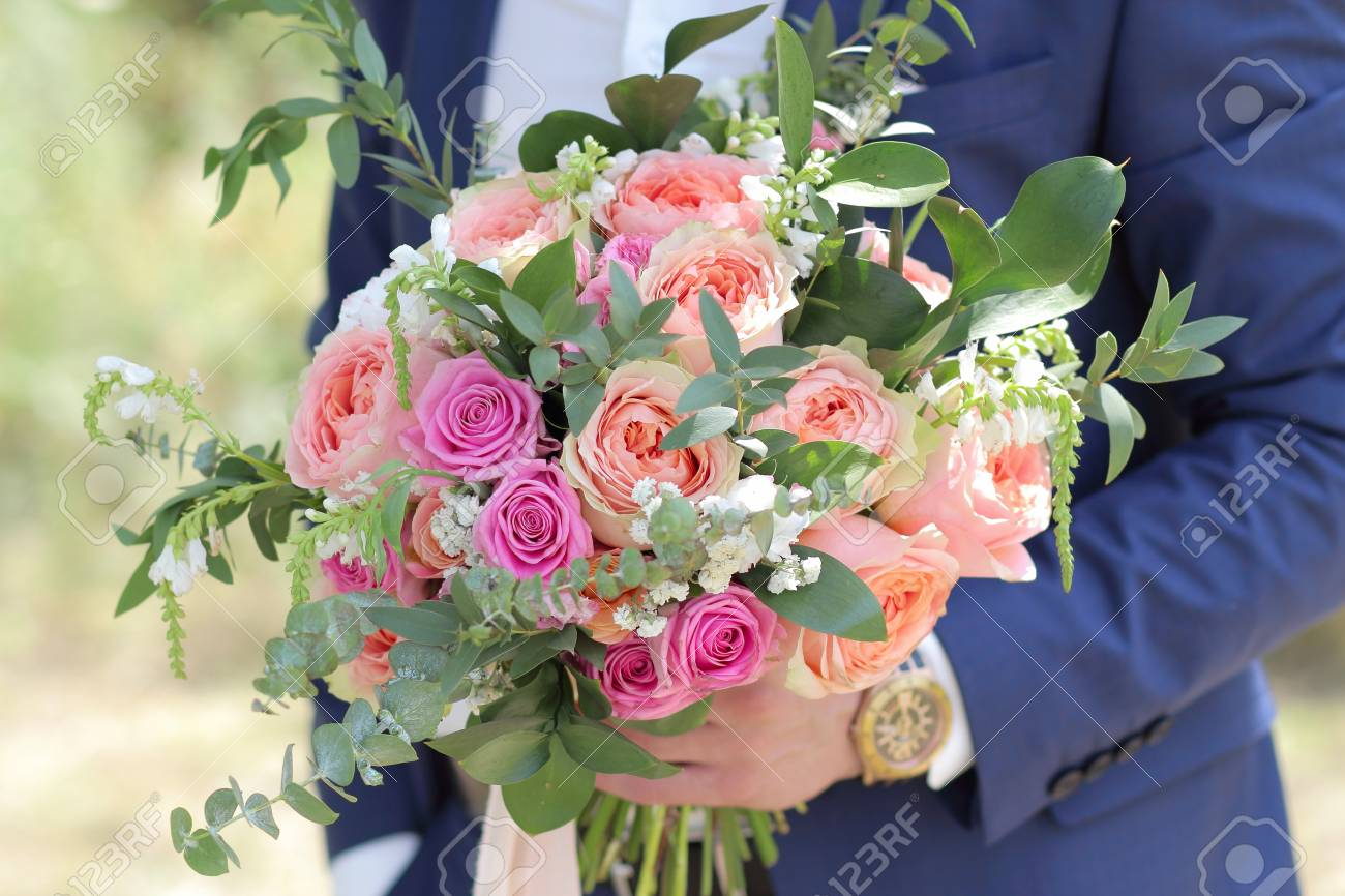Beautiful Bridal Bouquet In Hands Of The Groom. Wedding Bouquet ...