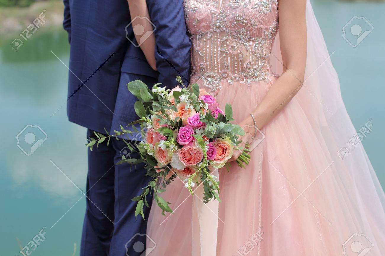 Beautiful bridal bouquet in hands of the bride wedding bouquet beautiful bridal bouquet in hands of the bride wedding bouquet of peach roses by david izmirmasajfo