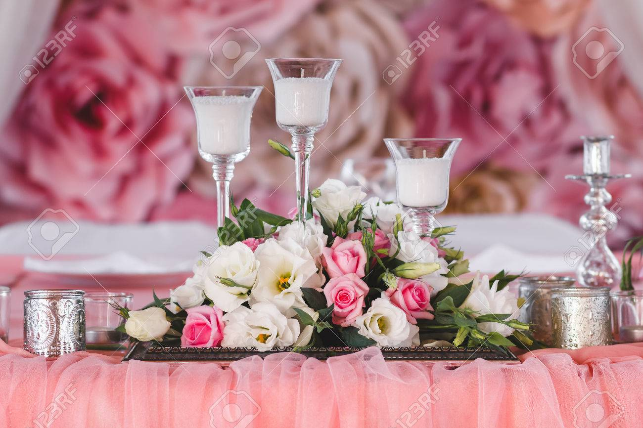 Wedding Table Decorated With Fresh Flowers, Candles And Silver ...