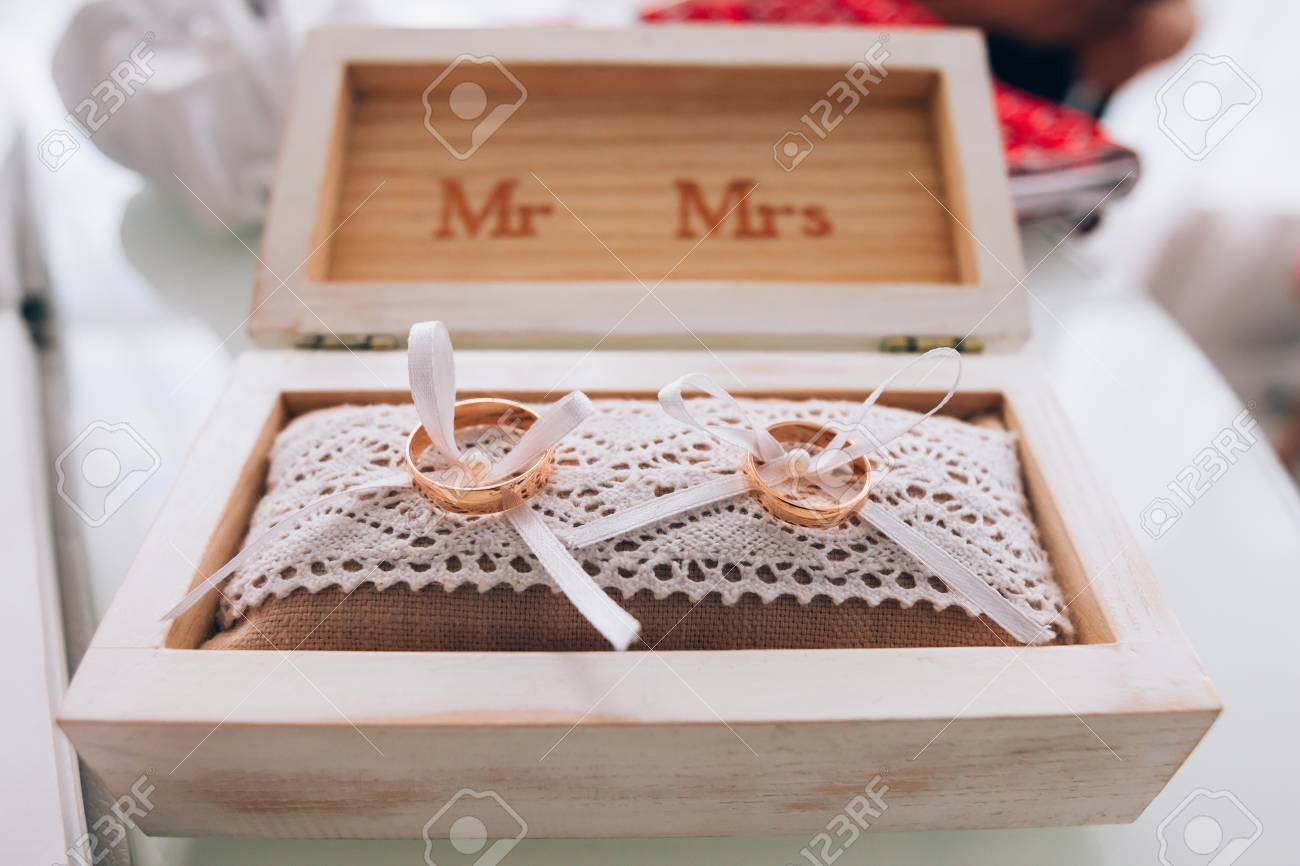 box love unity rings of engagement photo and symbol golden decoration a in royalty wedding family white wooden
