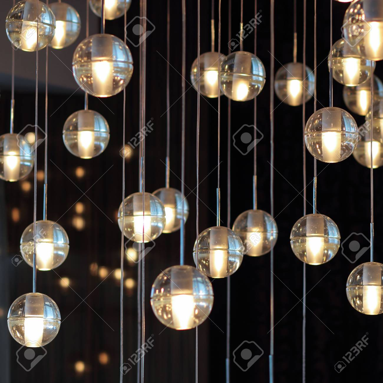 Lighting balls on the chandelier in the lamplight light bulbs lighting balls on the chandelier in the lamplight light bulbs hanging from the ceiling aloadofball Image collections
