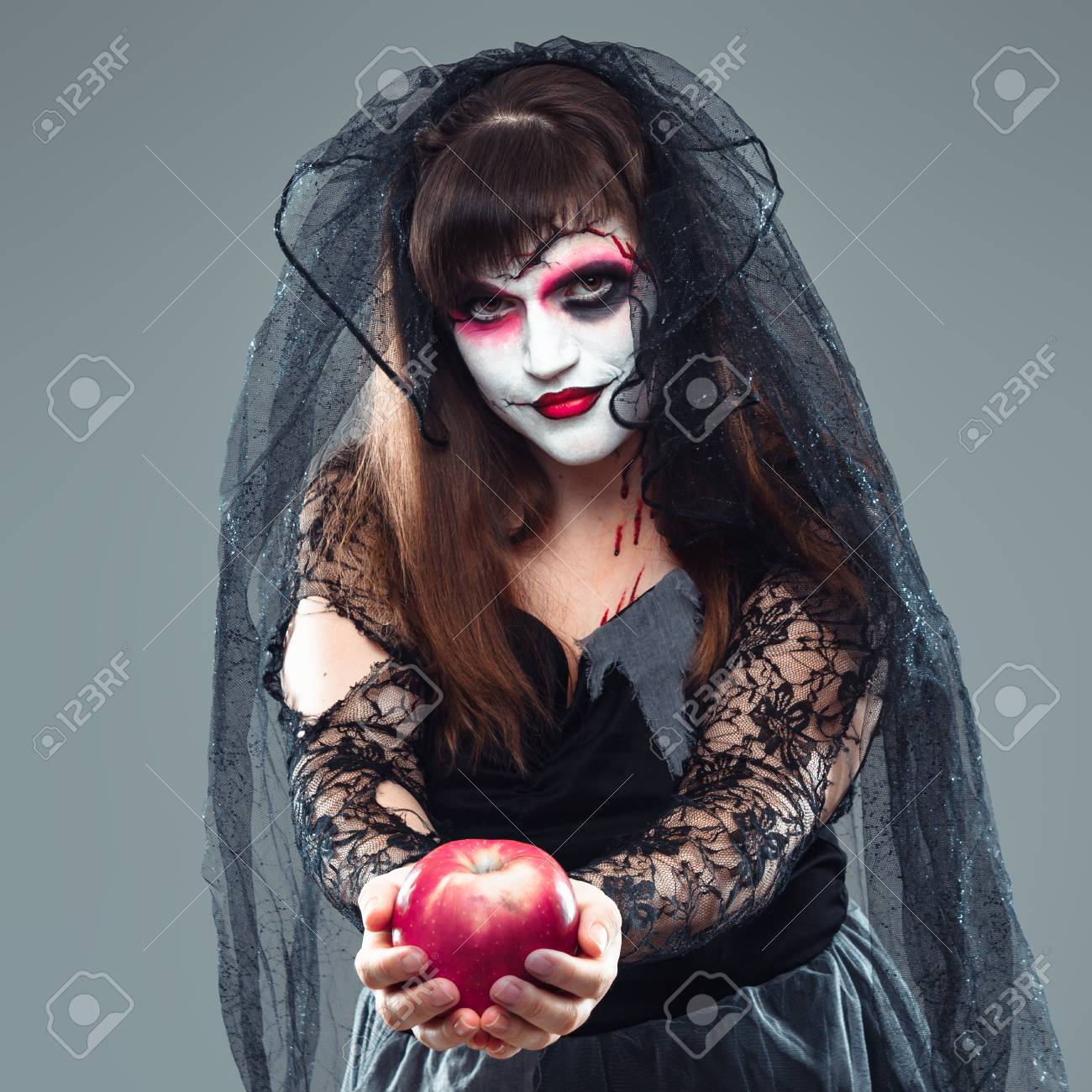 Dead Bride Halloween Costume.Woman In A Carnival Costume Of A Witch Or A Dead Bride Holding