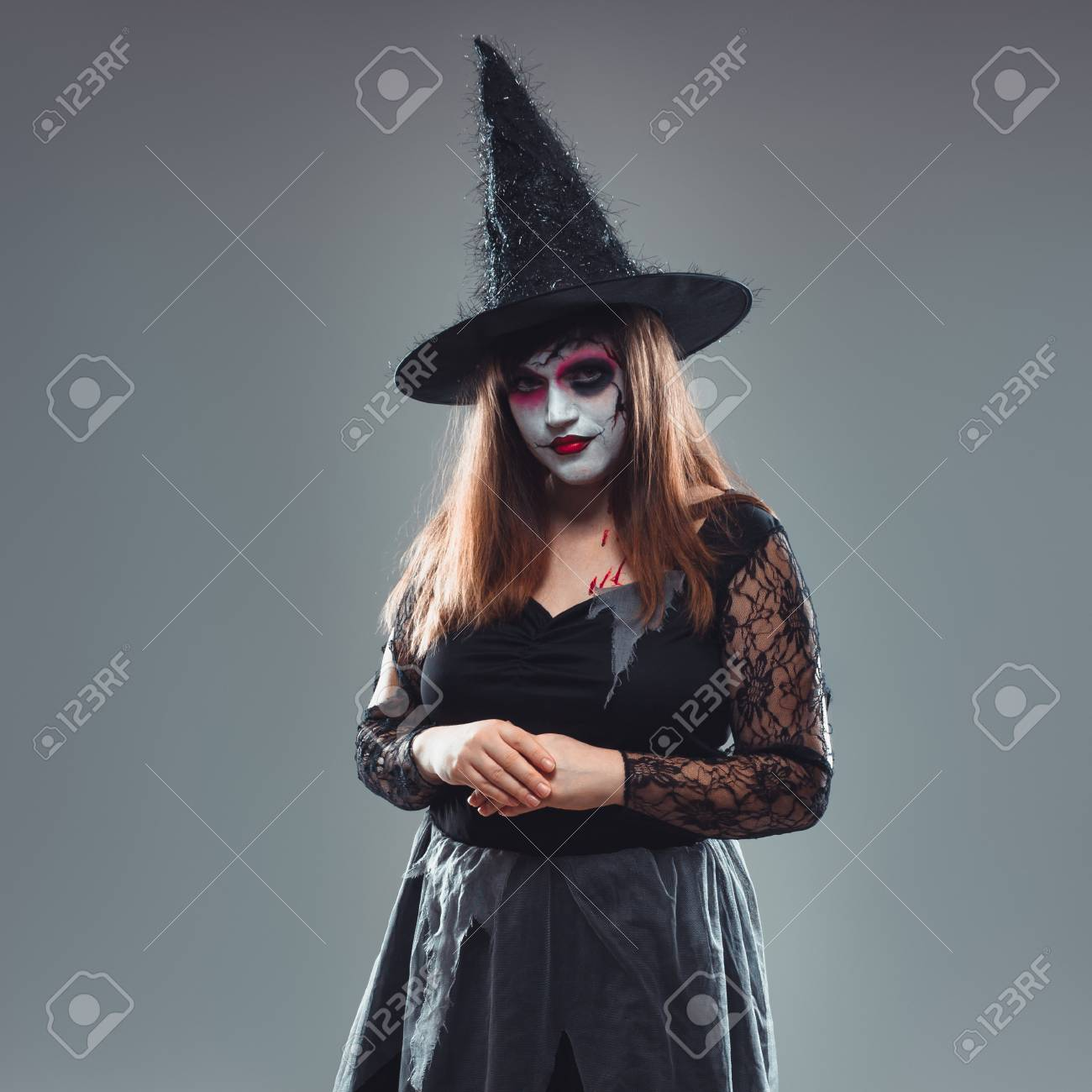 Dead Bride Halloween Costume.Gothic Young Woman In Witch Halloween Costume With Hat Standing