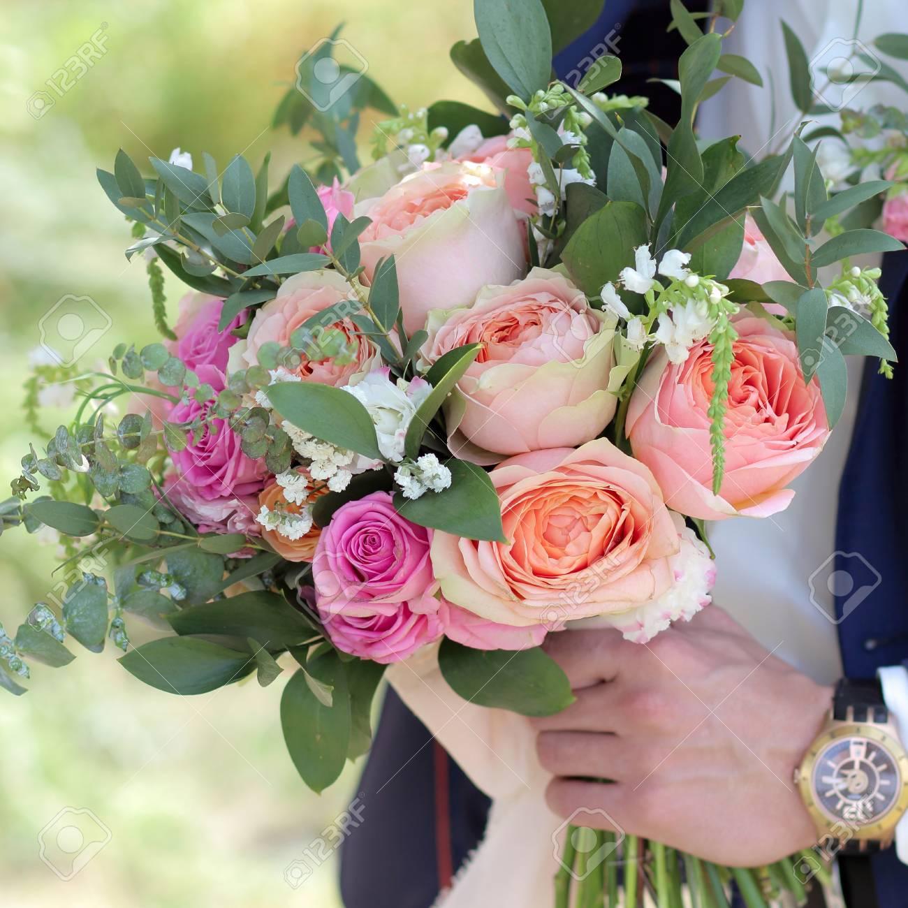 Groom Holding A Beautiful Bridal Bouquet. Wedding Bouquet Of Peach ...