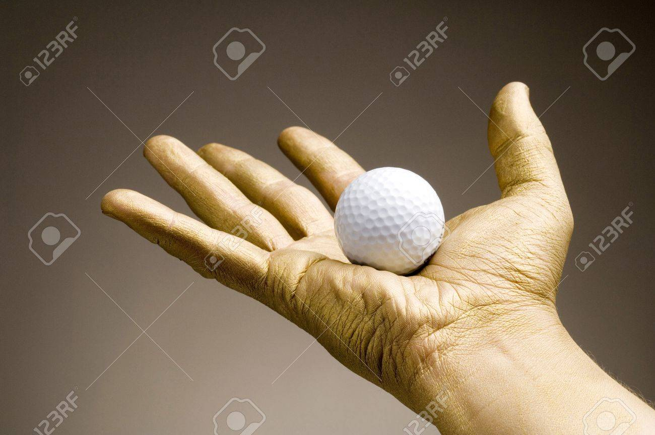 Golden hand holding golf ball Stock Photo - 3192965