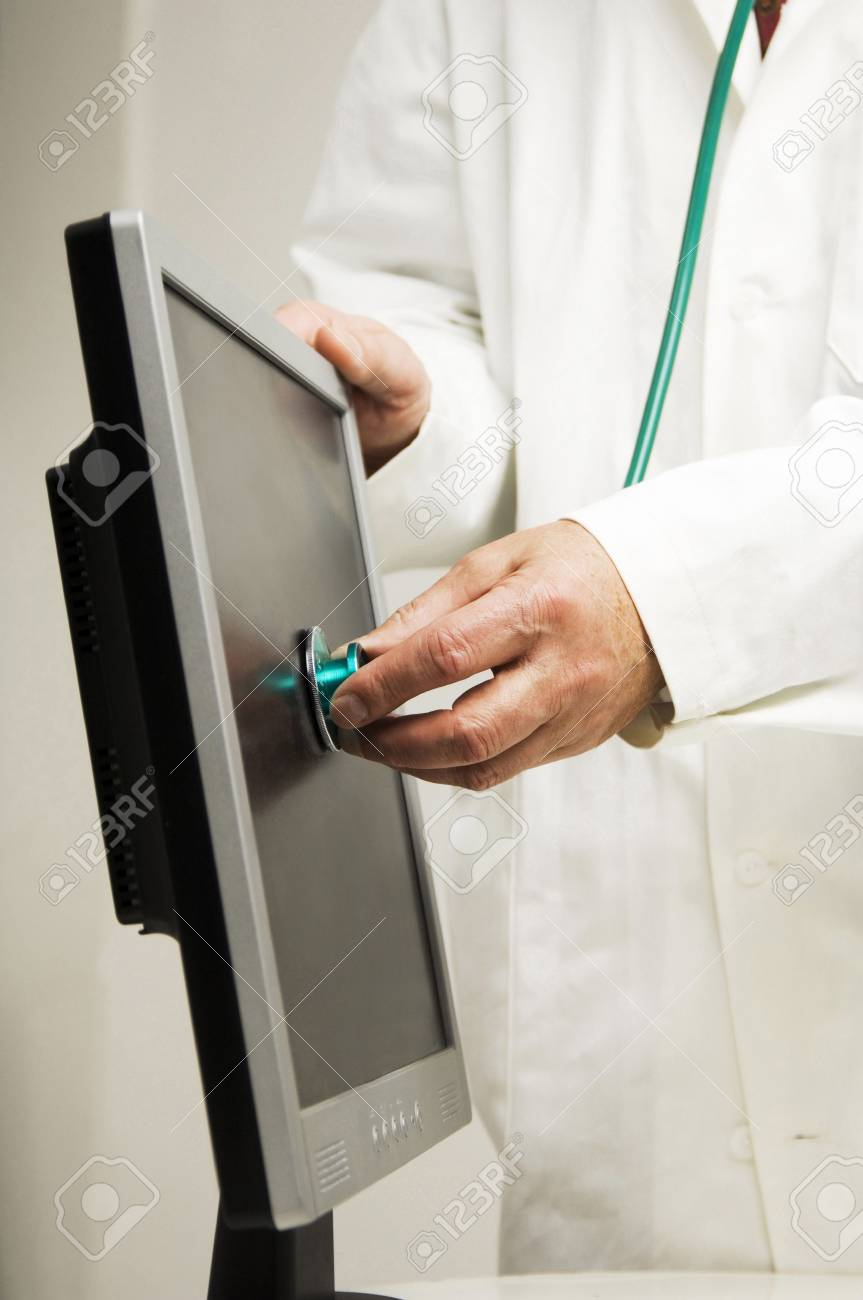 Doctor using a stethoscope on a flat screen computer monitor Stock Photo - 3193017