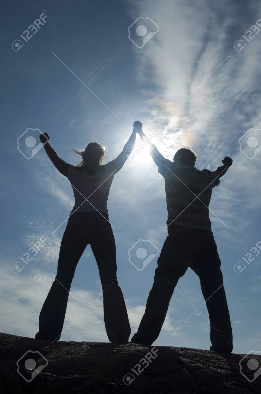 Couple raising and holding their hands Stock Photo - 3193449