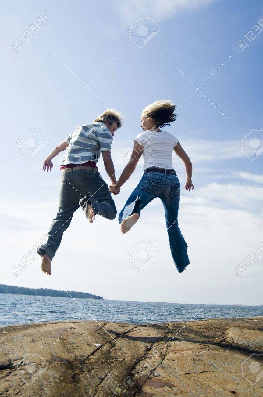 Couple jumping together Stock Photo - 3193457