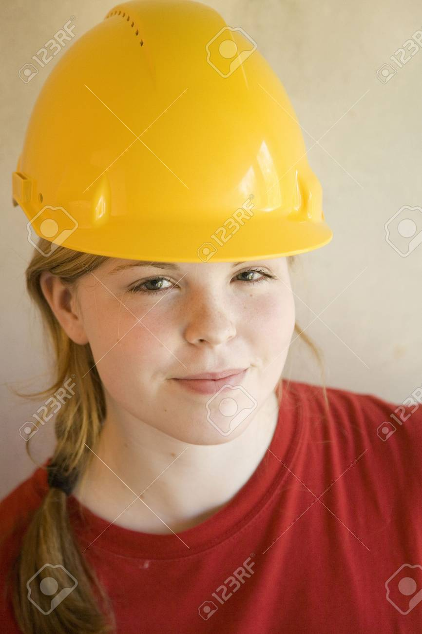 Teenage girl with safety helmet smiling at the camera Stock Photo - 3193583