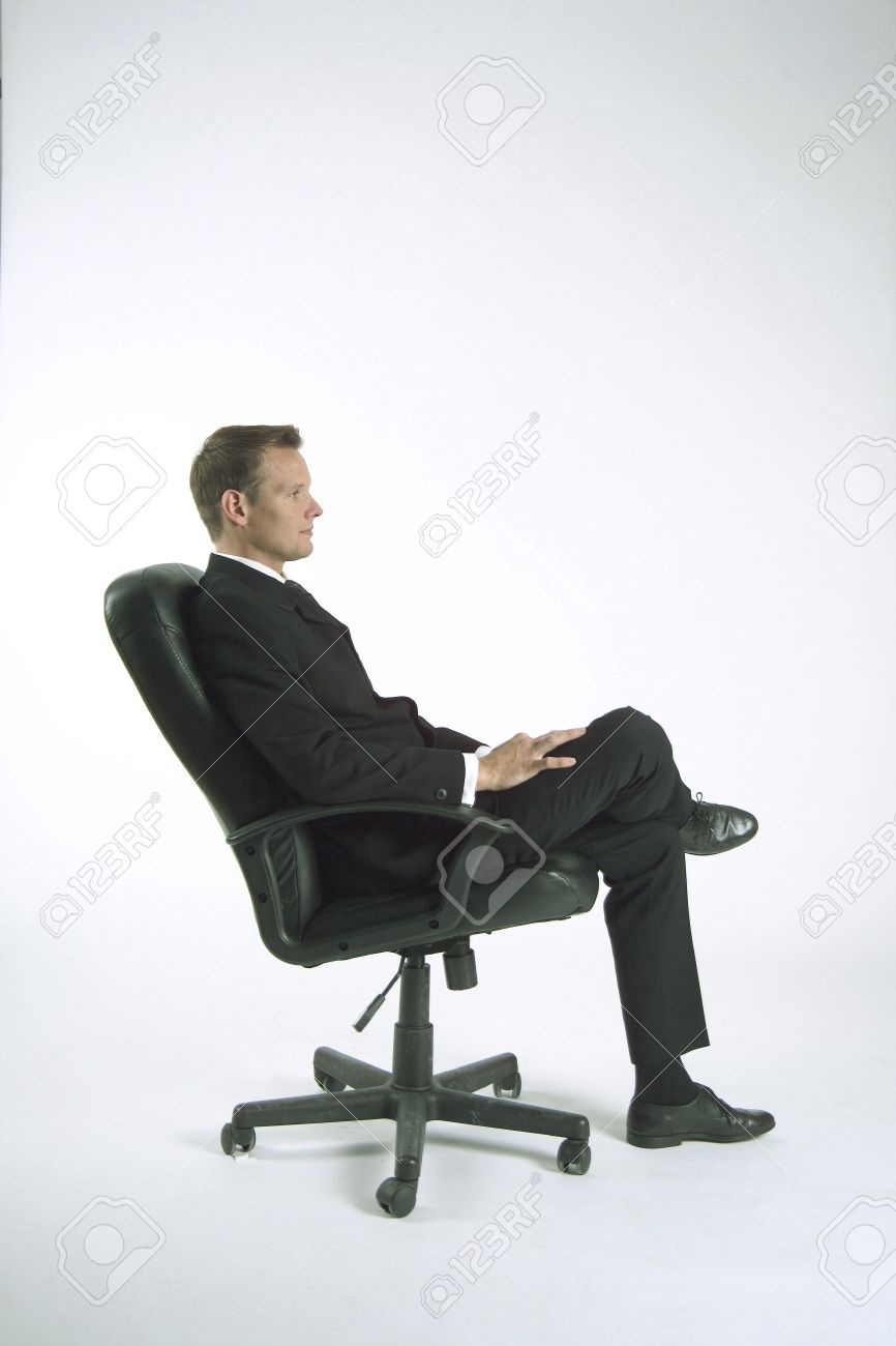 Man sitting in chair side - Businessman Sitting On Office Chair Side View Stock Photo 3193712