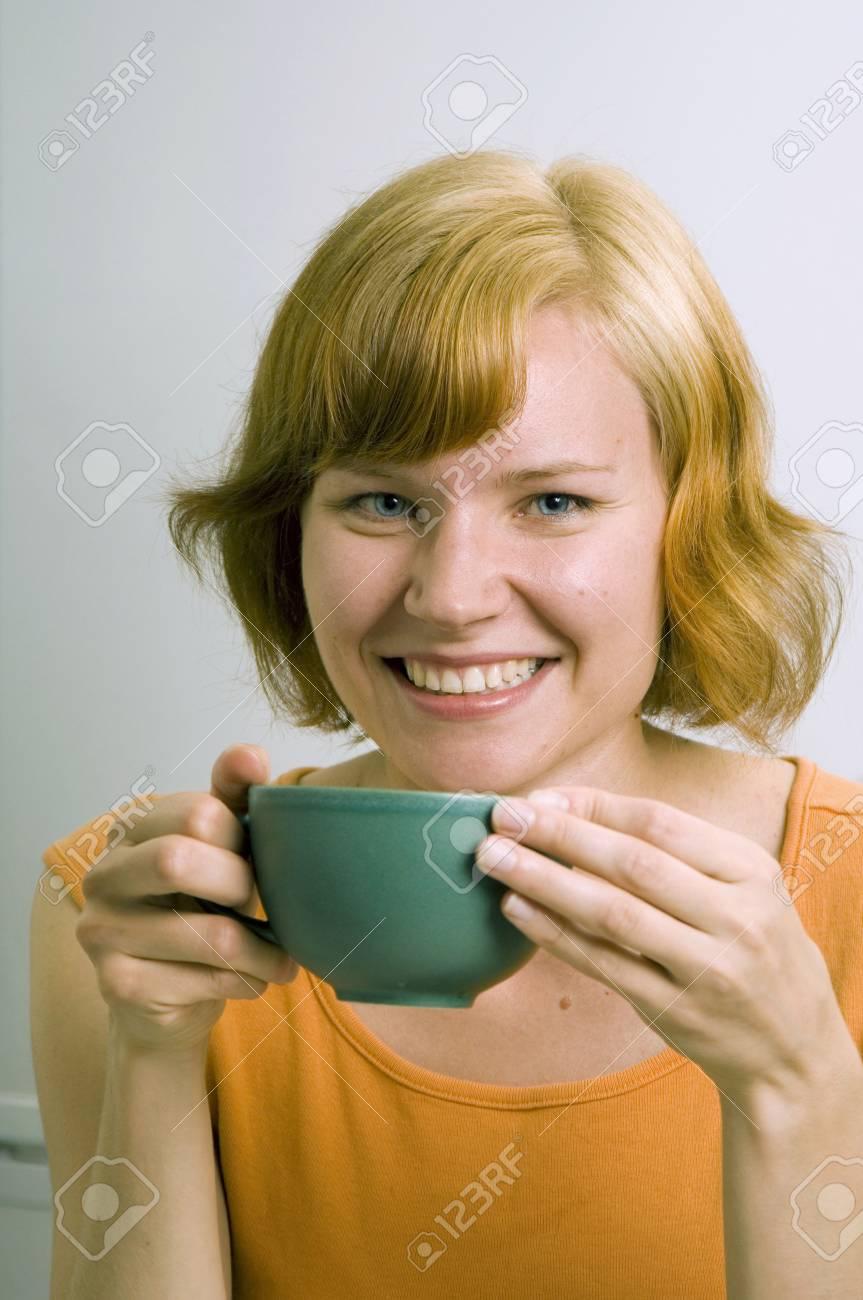 Woman enjoying a cup of tea Stock Photo - 3193820