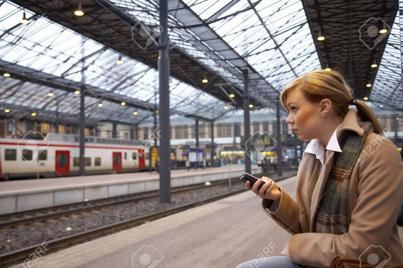 Woman text messaging while waiting for the train Stock Photo - 3194056