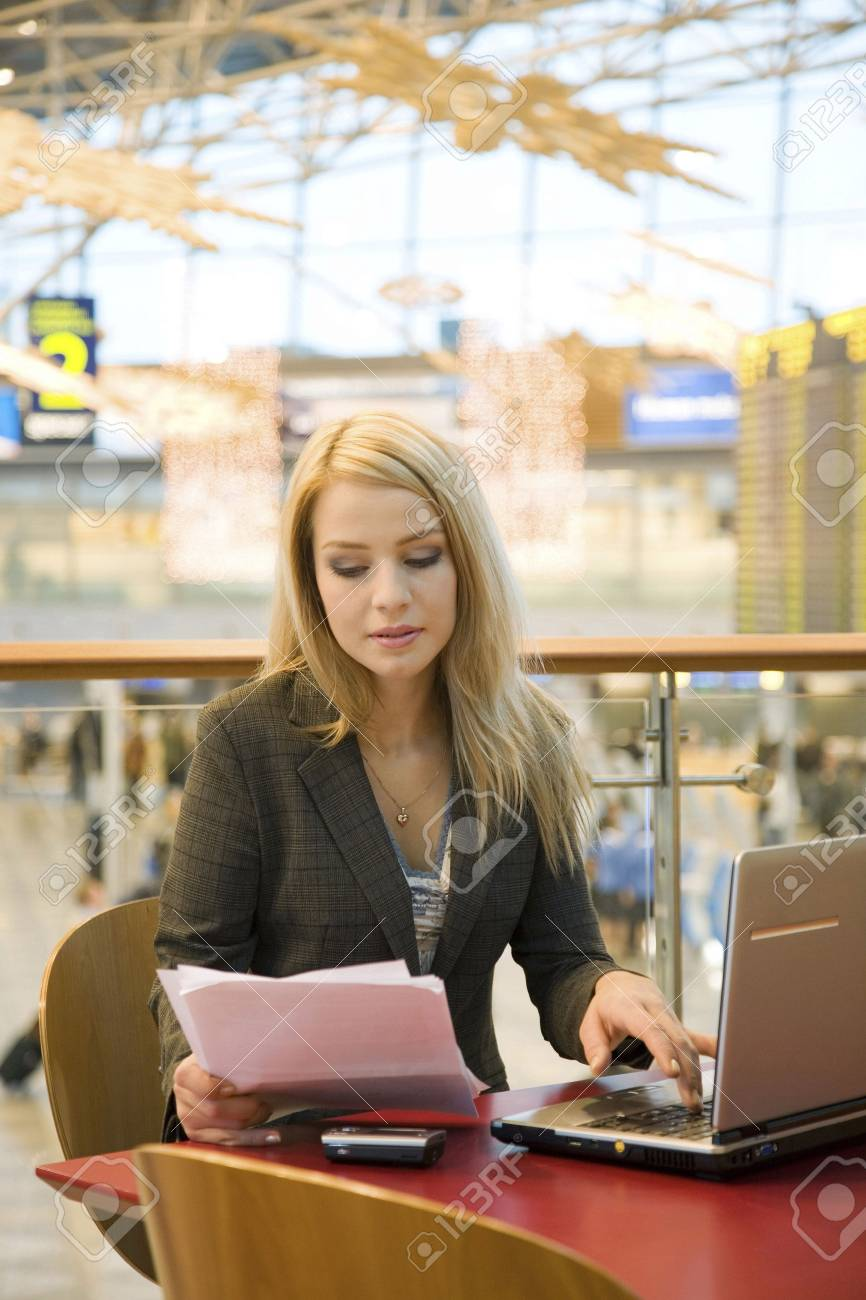 Businesswoman working in a cafe at the airport terminal Stock Photo - 3194074