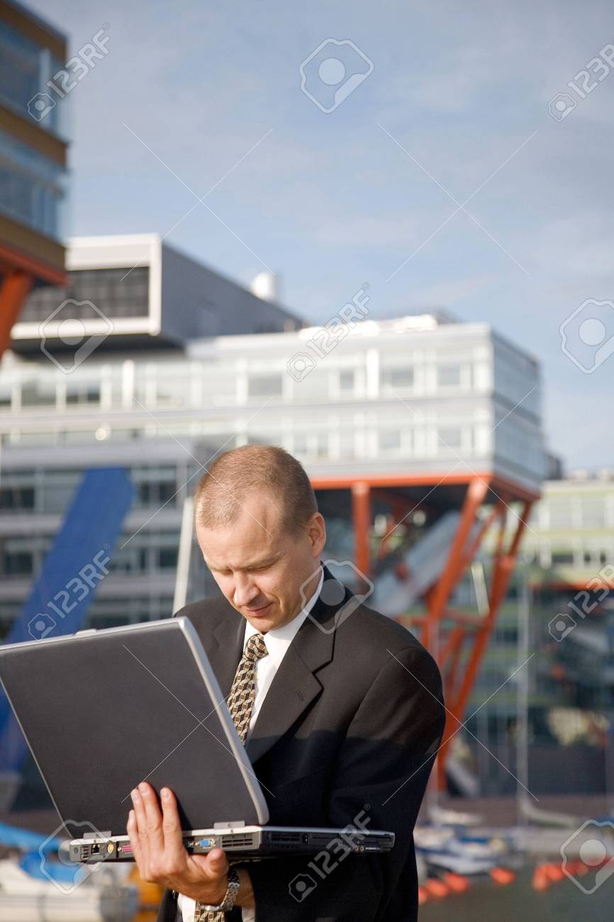 Businessman using laptop outdoors Stock Photo - 3194084