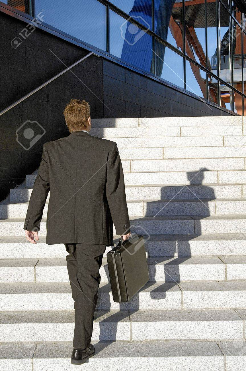Businessman walking up the stairs of a building Stock Photo - 3194122
