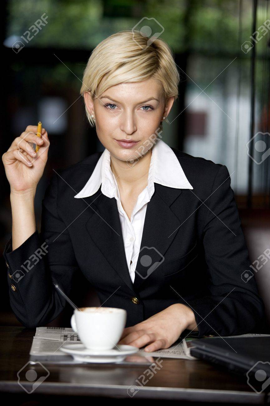 Businesswoman in a restaurant Stock Photo - 3194259