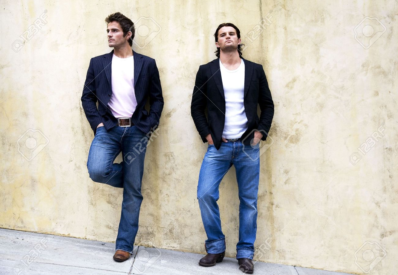 Two men leaning against the wall Stock Photo - 3194284