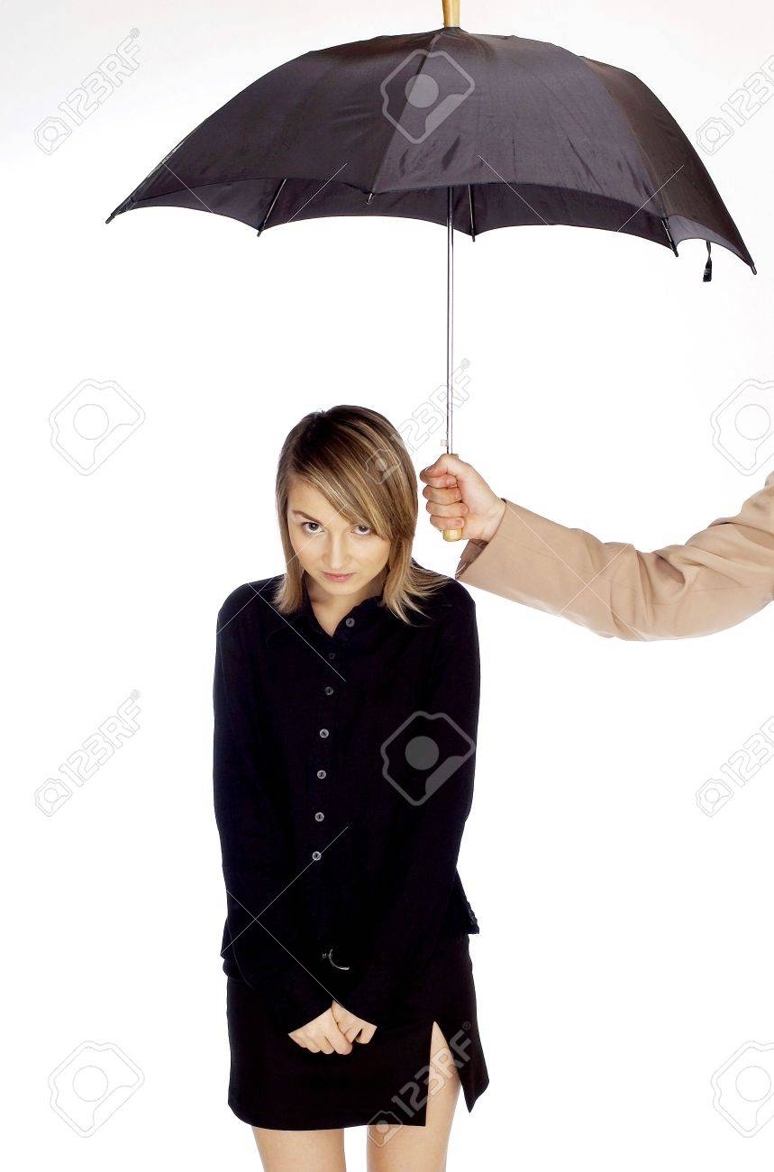 Man's hand shading woman with an umbrella. Stock Photo - 3192222