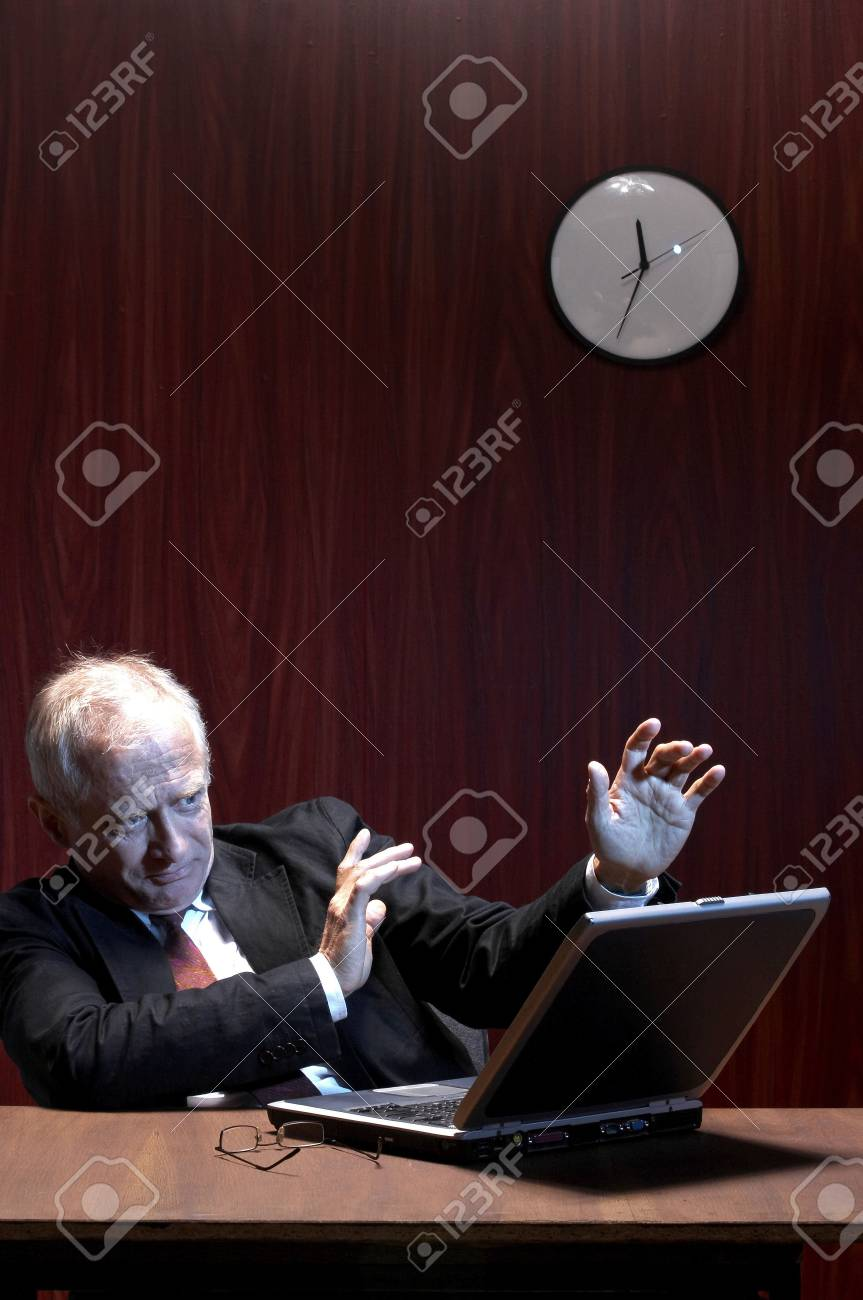 Businessman watching horror movie on the laptop. Stock Photo - 3192399