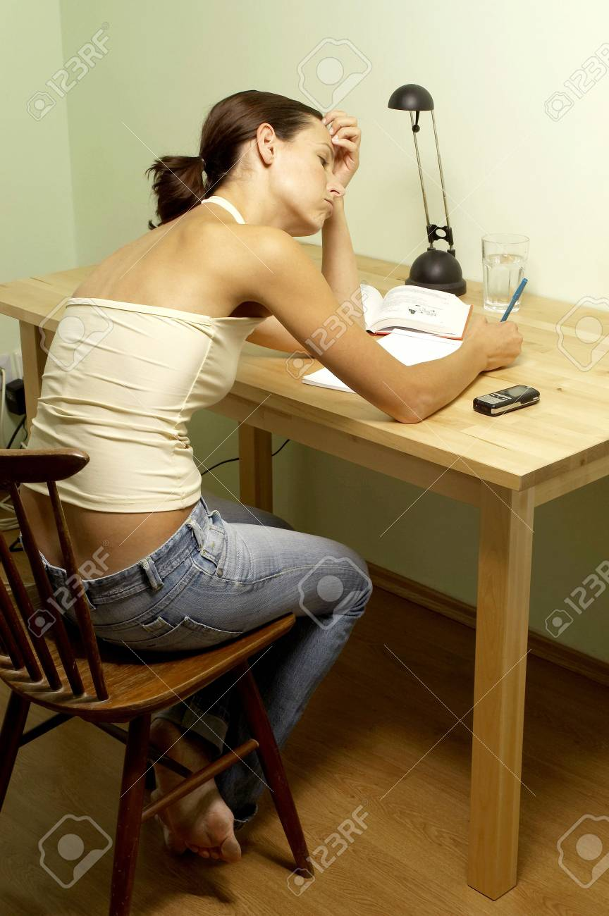 Woman doing assignment. Stock Photo - 3192472