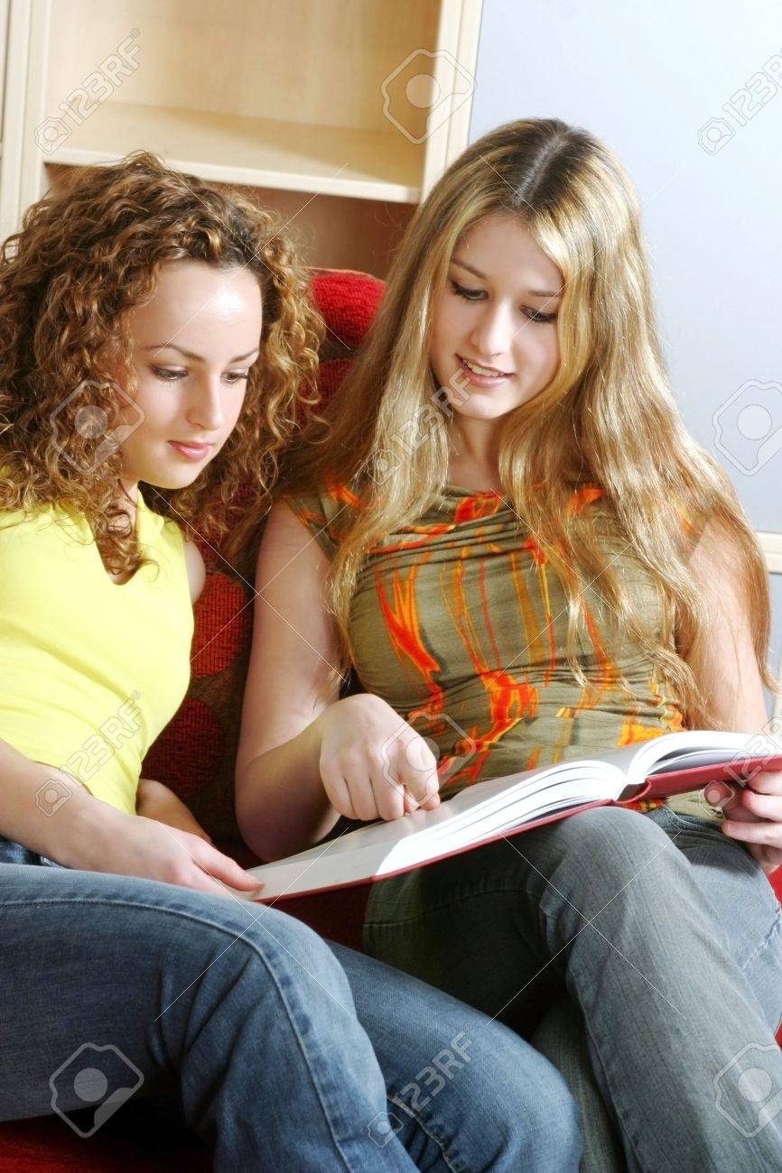 Two women sharing a book. Stock Photo - 3191368